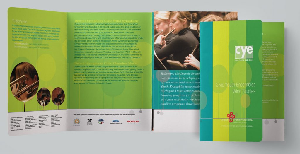 DSO civic brochure with bold stripes of color, a music line, and playful circles that are sometimes photo holders