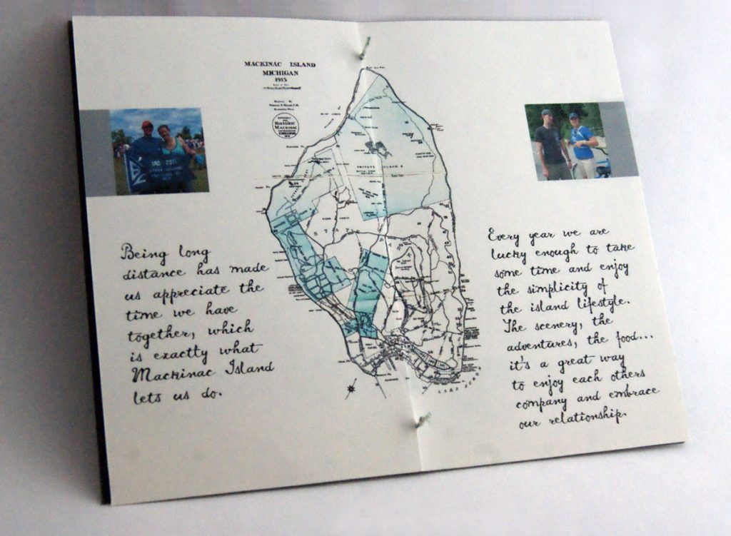 large vintage map of the island, photos of the bride and groom, and story